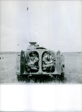 View of a military vehicle in a field.