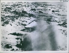 1942 A tent blazing in the foreground during the attack on camp at Gazala.