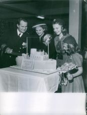 Captain Carlsen while cutting the cake with his family.