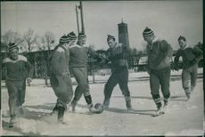 Footballers playing football on ice. 1947