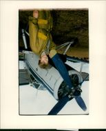 A woman standing beside of the plane.
