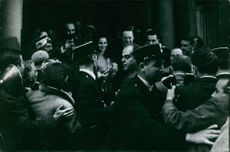 A photo of John Albert Edward William Spencer-Churchill, 10th Duke of Marlborough wit the press people and a lady guest.