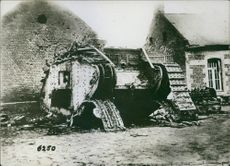 A destroyed military tank in the street in France during World War I, 1936.