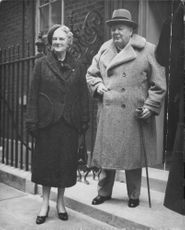 Winston Churchill with his wife standing on their door steeps.