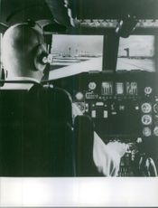 Pilot siting on a cockpit and operating to take off.