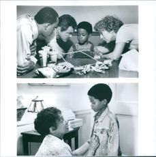 """Ralph Wilcox, Holland Taylor, Ruby Dee, Burton Reynolds, and Norman Golden II, in a scenes of the film, """"Cop and a Half""""."""