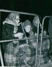 A photo of women in Netherlands waiting during the Queen Wilhelmina's funeral rites. 1962