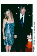 "Michelle Pfeiffer along with her husband David E. Kelley at the premiere of ""The Story About Us"""