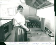 A woman cooking in the kitchen.
