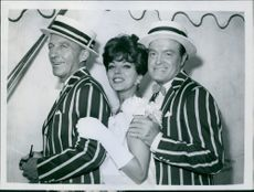 Bing Crosby, Joan Collins and Bob Hope on the set of the film The Road to Hong Kong, 1962.