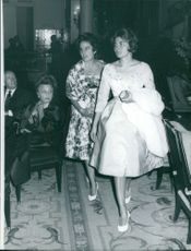 Princess Soraya of Iran walking and another women behind her.