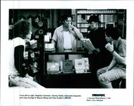 From left to right, Stephen Gavedon, Harvey Keitel, Giancarlo Esposito and Jose Zuniga in the film Smoke.