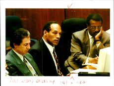 OJ Simpson , flanked by his defense attorneys Robert Kardashian and Johnnie Cochran Jr.