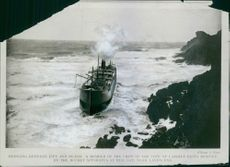 Swinging between life and death, a member of the crew of the city of Cardiff being rescued by the rocket apparatus at Mill Bay, near Land's End.