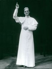 A pope standing.
