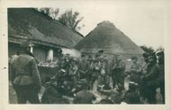 Soldiers gathered in the village during the WWI,.