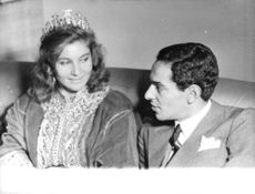 Lamia Solh looking at Prince Moulay Abdellah of Morocco on their wedding day.