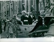 Juliana of the Netherlands is sitting on a carriage with her husband Prince Bernhard, Prince smiling