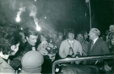 People gathered in night. Photo taken March 5, 1964