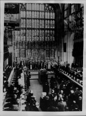 Queen Elizabeth and Queen Mother stand at King George VI's chest before immersion in the floor of St. George's Chapel