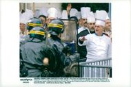 Restaurant owners and cooks throw eggs on the police during a demonstration in protest against high taxation at restaurants