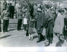 Sukarno walking in many people