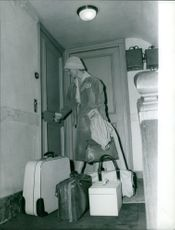 Michelle Morgan packing her suit cases.