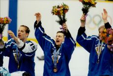 The match's hero, Ville Peltonen, celebrates with flowers after Finland defeated Canada with 3-2 in the bronze match in the Olympic Games.