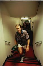 Tennis player Stefan Edberg with flower bouquet in hand after the loss against Nicklas Kulti in Stockholm Open 1996