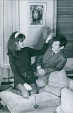 French actress Danielle Gaubert is joking with her husband Olympic ski champion Jean-Claude Killy