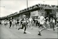 Stockholm Marathon 1987. Slusskarusellen offered a beautiful view. The man in white cap is one of the race's older runners, 72-year-old Gerrit Bait