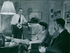 """Barbro Hiort af Ornäs, Sven-Eric Gamble and Ulf Palme in a scene of the 1950's film """"While the City Sleeps""""."""
