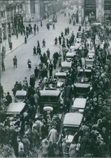 Image shows a shot from Milan, where the first group of Italian car owners and trucks were delivered to the headquarters of the fascist party.