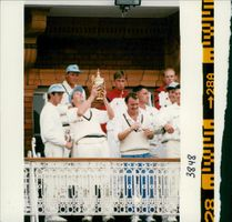 Dominic Cork English cricketer Holding a Trophy with Derby V.Lanes.
