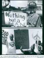 1996 Top- A young boy shows his solidarity. Bottom- Two million man marchers show their enthusiasm in Columbia Pictures' drama of solidarity and self-discovery during a scene in film Get on the Bus.