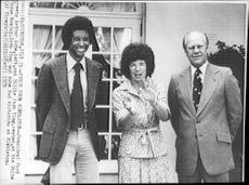 American tennis players Arthur Ashe and Billie Jean King with US President Ford upon receipt in the White House after their win in Wimbledon