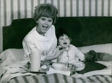 France Anglade is with a baby. 1964