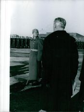 1959 A  photo of a British Conservative politician and statesman who served as the Prime Minister of the United Kingdom from 10 January 1957 to 18 October 1963 Maurice Harold Macmillan looking towards soldiers while in Moscow.