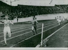 Athletes running on track during Olympics.