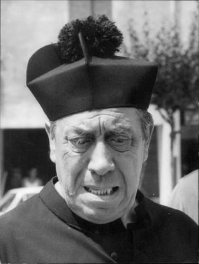 "Fernandel as Don Camillo in the movie ""Don Camillo's Little World""."