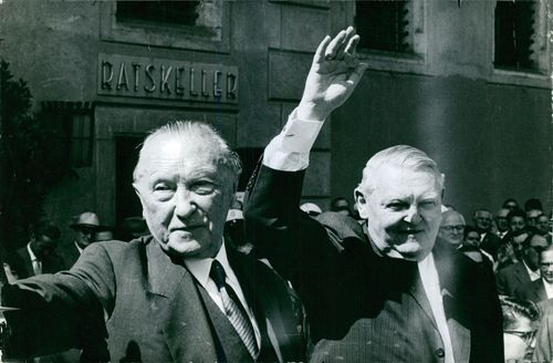 Ludwig Erhard waving with man.
