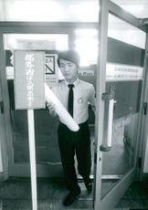 A Japanese entering a car factory in Tokyo, Japan.