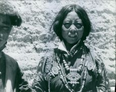 Man and woman standing and looking in Nepal. 1964