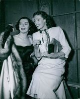 Portrait of an American actress Rosalind Russell was visited by her friend Loretta Young on set, the girls compared the recent additions to their collections of jewelry.
