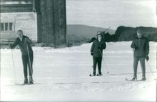 Princess Beatrix skiing with men.
