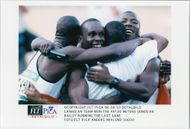 Canadian team team with Donovan Bailey after the 4x100 meter win at the Atlanta Olympic Games in 1996