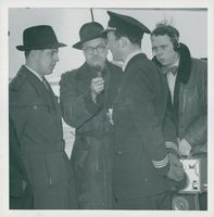 Sven Karlsson and Captain Falkman, along with Manne Berggren who holds the microphone