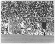Clive Wilson and Michael Stockwell are fighting for the ball