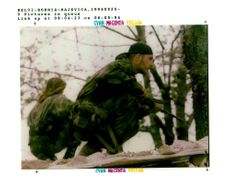 Bosnian Serb soldiers on top of their shelter.