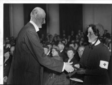 Prince Carl award the Red Cross Medal to Sister Lisa Boström. - 28 May 1938